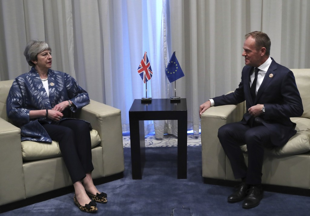 European Union Council President Donald Tusk, right, speaks with British Prime Minister Theresa May during a bilateral meeting on the sidelines of a s