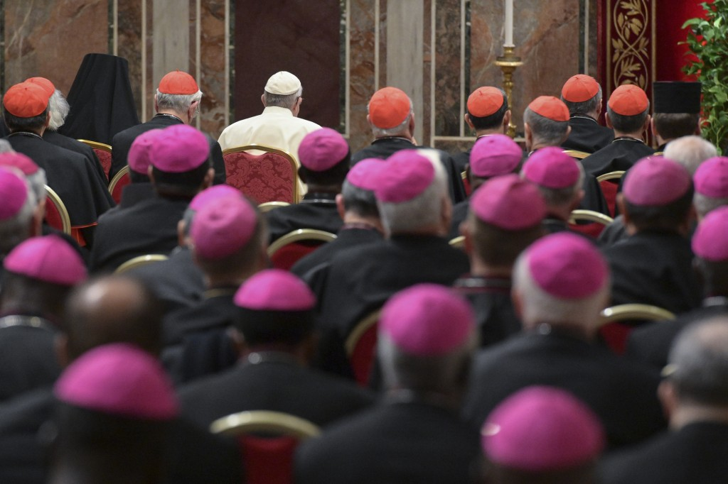Pope Francis, background third from left, attends a penitential liturgy at the Vatican, Saturday, Feb. 23, 2019. The pontiff is hosting a four-day sum...