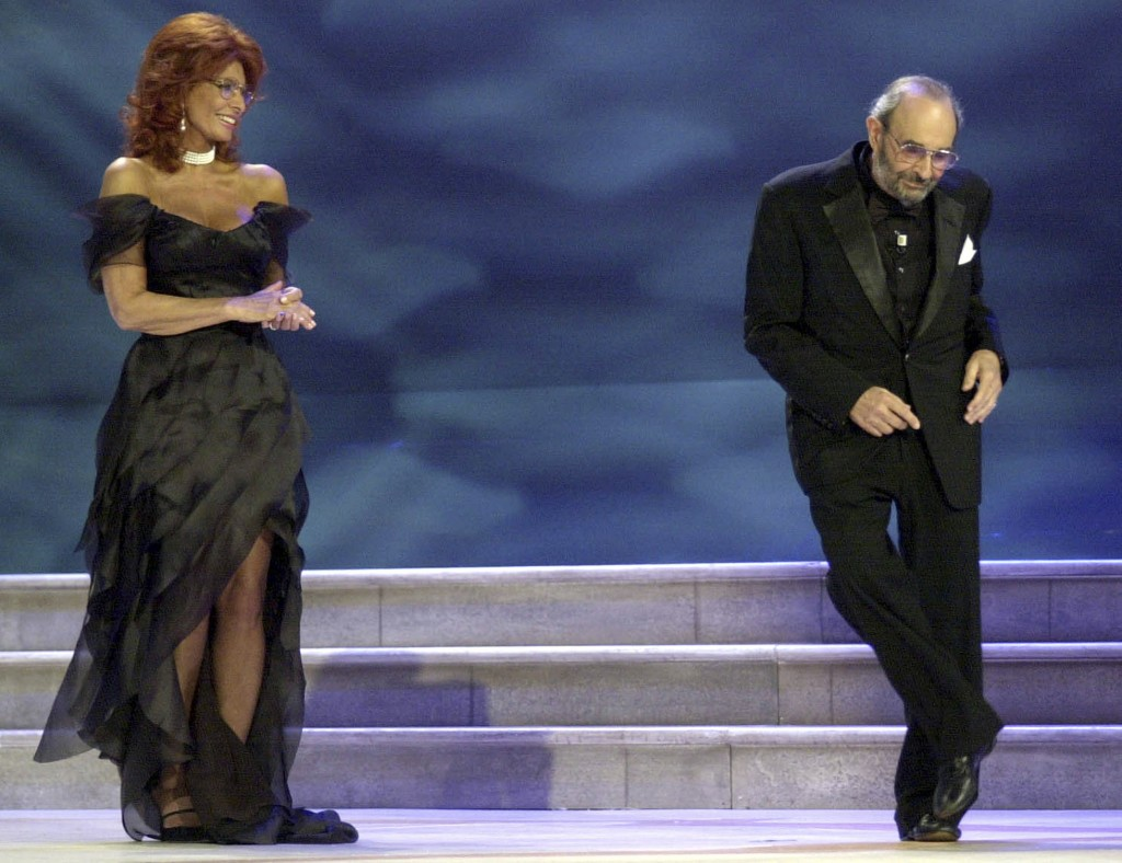 FILE - In this Sept. 11, 2004 file photo, Italian Actress Sophia Loren looks at US Director Stanley Donen dancing on the stage, during the awarding ce...