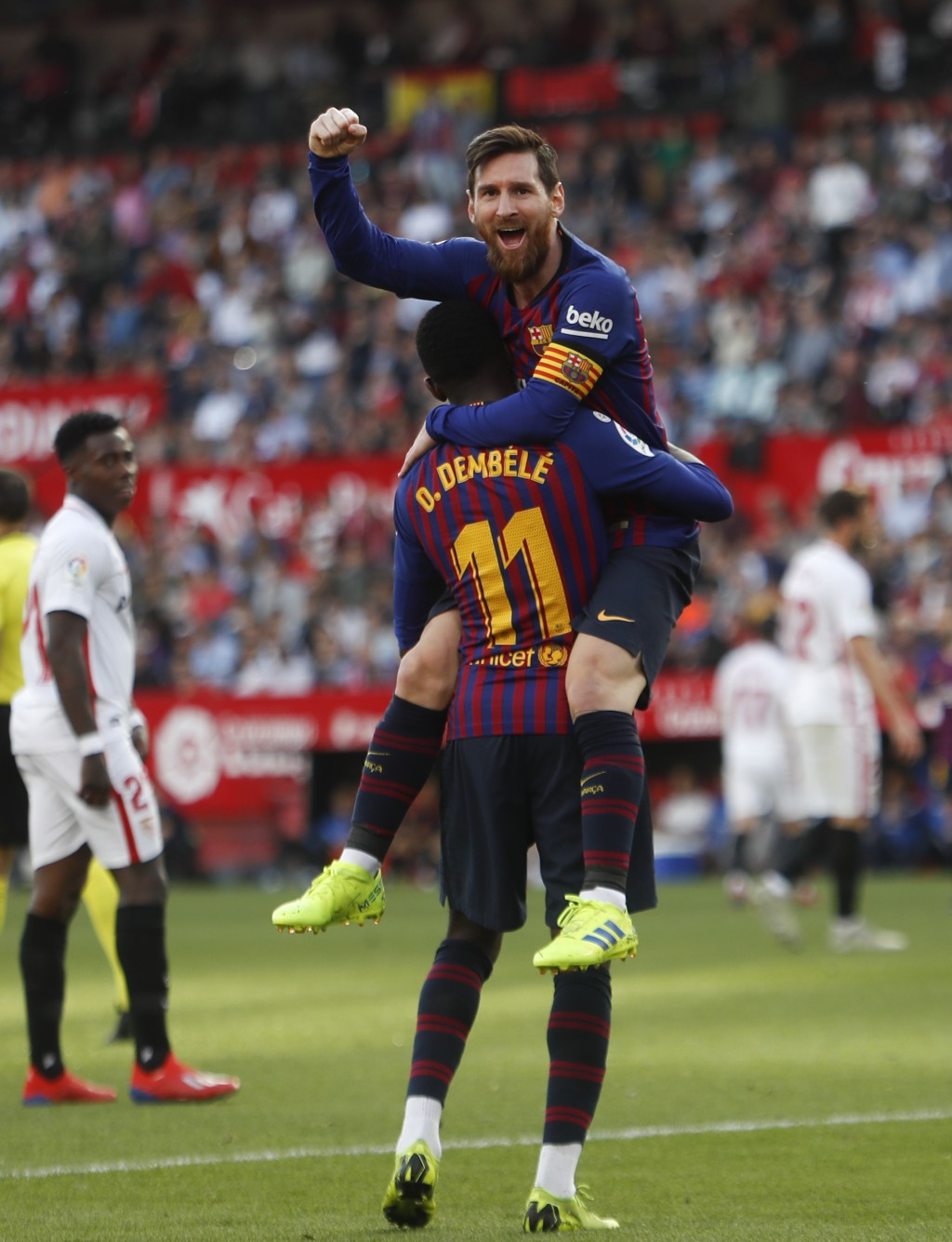 Barcelona forward Lionel Messi with his teammate Ousmane Dembele celebrate after scoring his side's second goal during La Liga soccer match between Se...