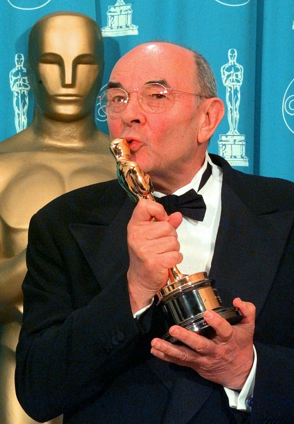 FILE - In this March 23, 1998 file photo, director Stanley Donen kisses the Oscar he received for Lifetime Achievement backstage at the 70th Academy A...