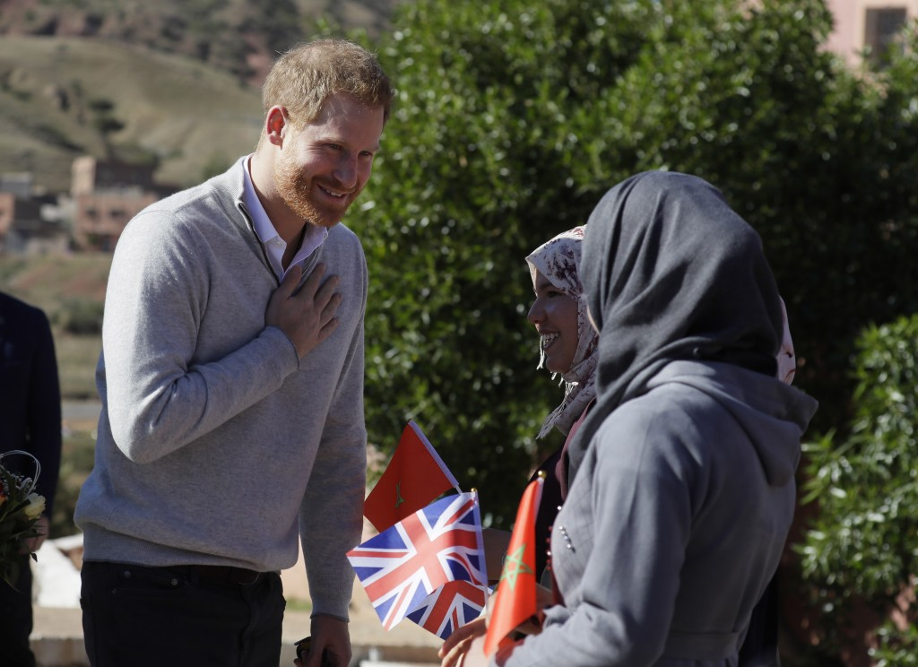 Britain's Prince Harry gestures as he arrives for a visit to an 'Education for All' boarding house in Asni Town in Morocco, Sunday, Feb. 24, 2019. The