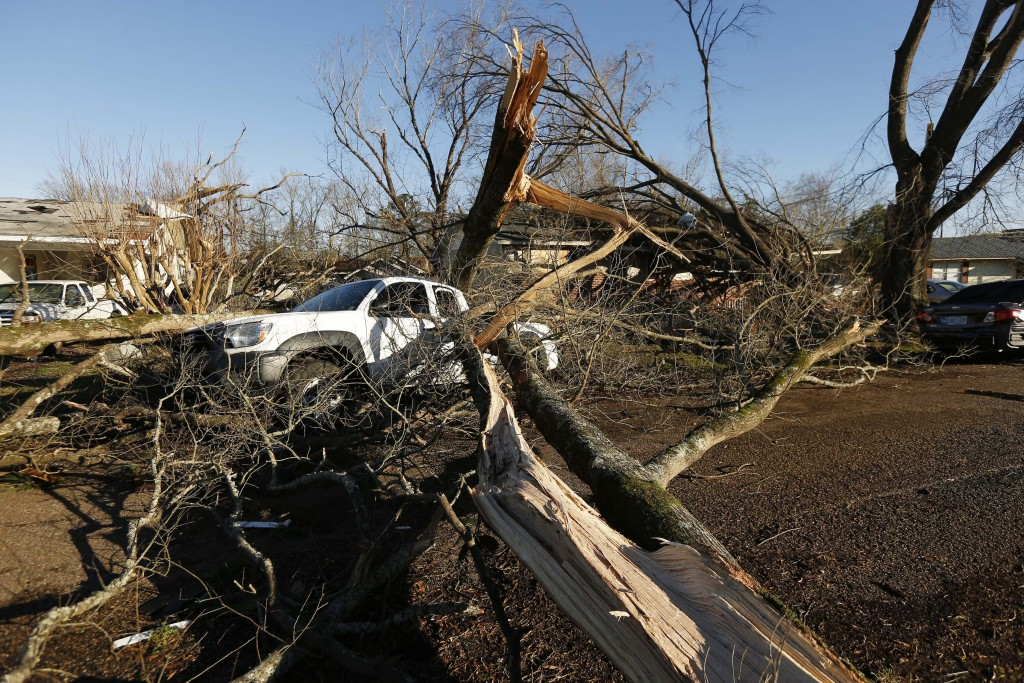 Tornado strewn debris and fallen trees in this Columbus, Miss., neighborhood, Sunday morning, Feb. 24, 2019. At least one person was killed among the