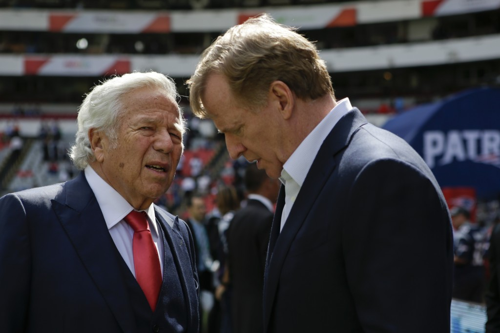 FILE - In this Nov. 19, 2017, file photo, NFL Commissioner Roger Goodell, right, talks with New England Patriots owner Robert Kraft before the Patriot