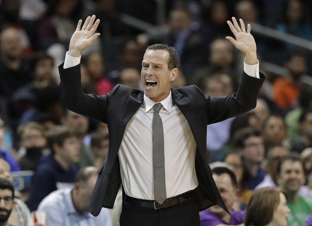Brooklyn Nets head coach Kenny Atkinson reacts to a call during the first half of an NBA basketball game against the Charlotte Hornets in Charlotte, N