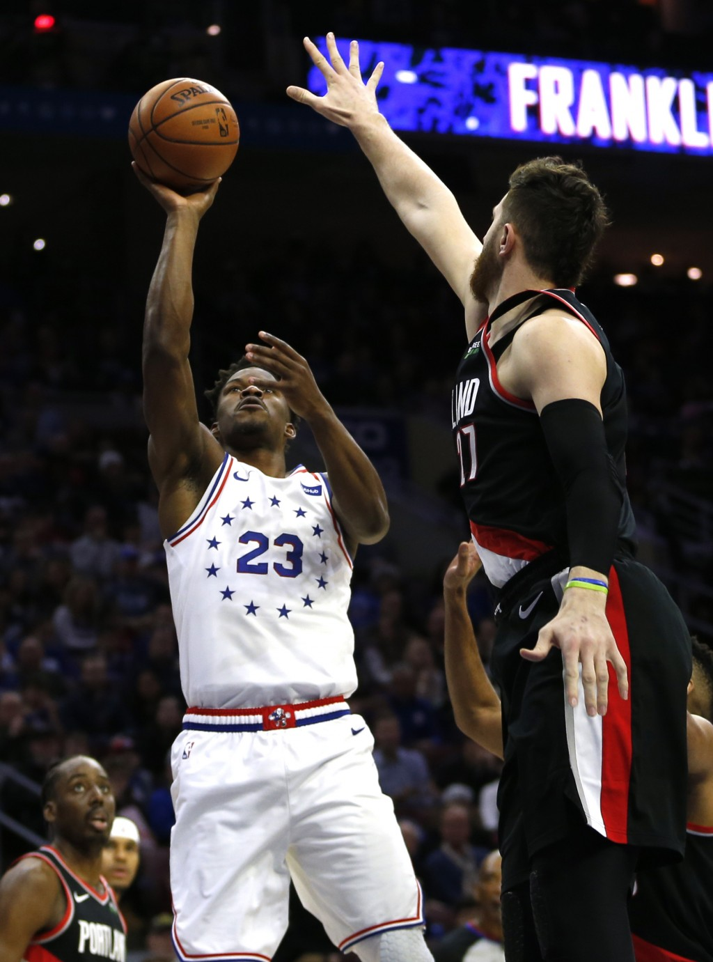 Philadelphia 76ers guard Jimmy Butler (23) takes a shot over Portland Trail Blazers center Jusuf Nurkic (27) during the first half on an NBA basketbal...