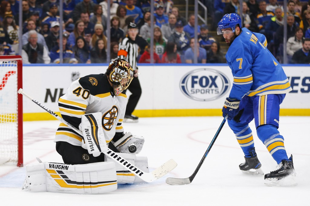 Boston Bruins goalie Tuukka Rask, left, of Finland, makes a save against St. Louis Blues' Patrick Maroon during the second period of an NHL hockey gam...