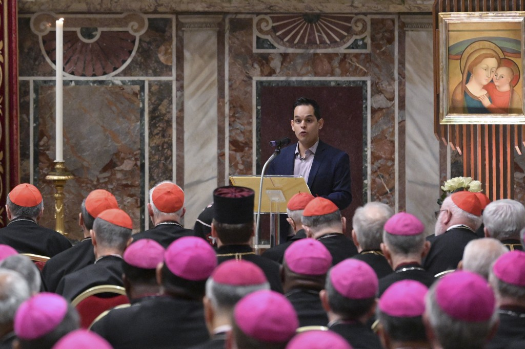 A survivor of sex abuse, who wished to remain anonymous, background right, delivers his testimony during a penitential liturgy attended by Pope Franci