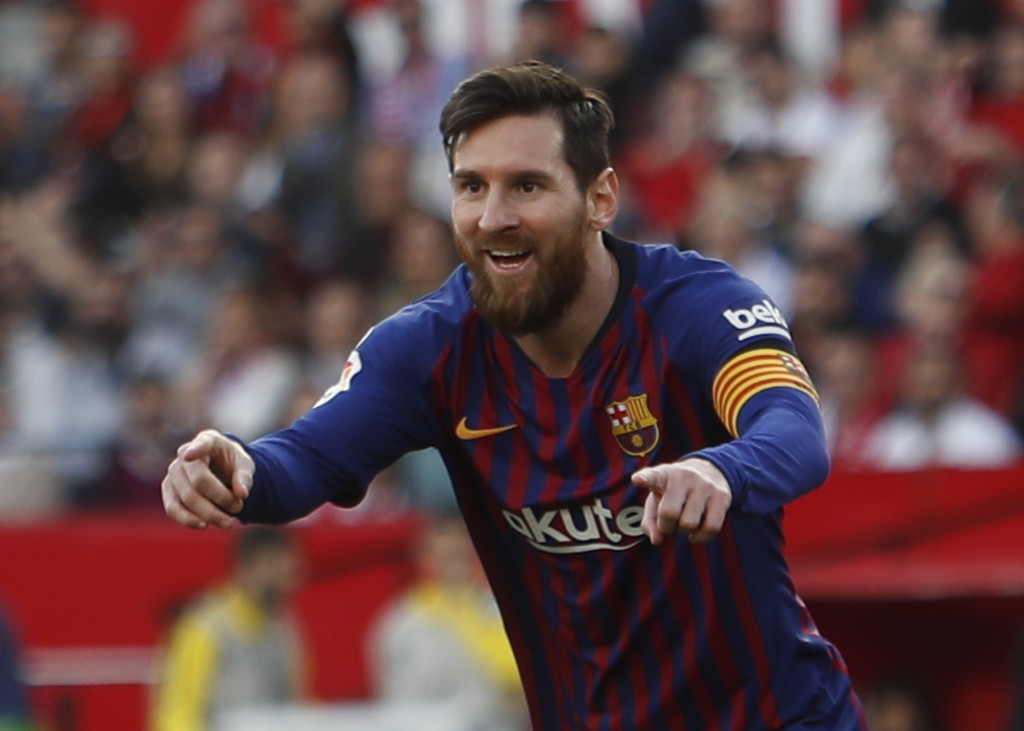 Barcelona forward Lionel Messi celebrates after scoring his side's second goal during La Liga soccer match between Sevilla and Barcelona at the Ramon