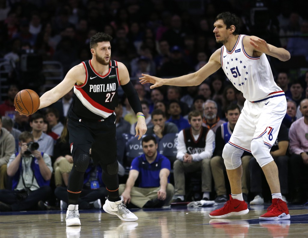 Portland Trail Blazers center Jusuf Nurkic (27) moves the ball around Philadelphia 76ers center Boban Marjanovic (51) during the first half on an NBA ...