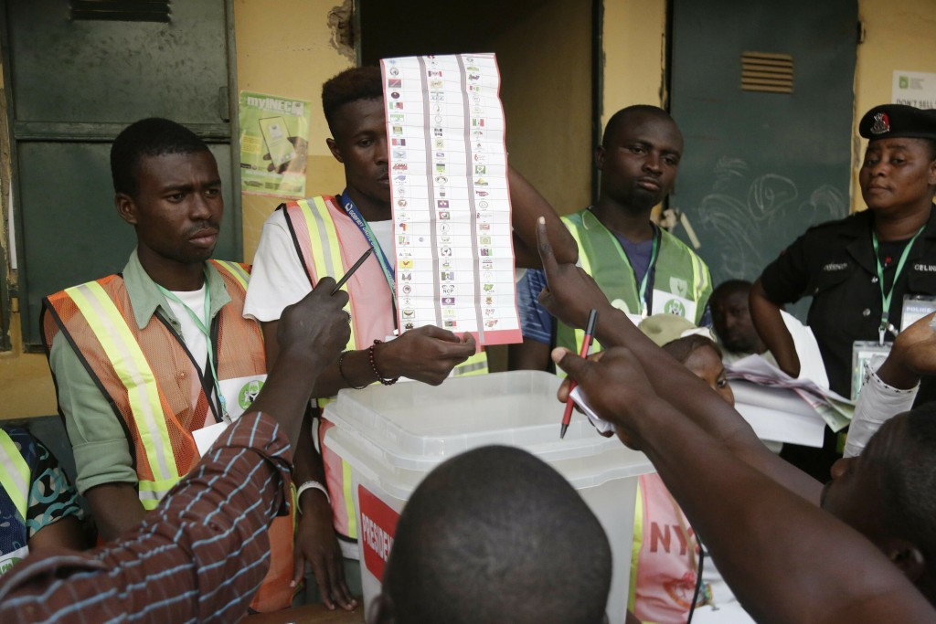 Party agents argue with electoral commission officials on a ballots the claim it was valid for the presidential race after the Gwadabawa polling stati...