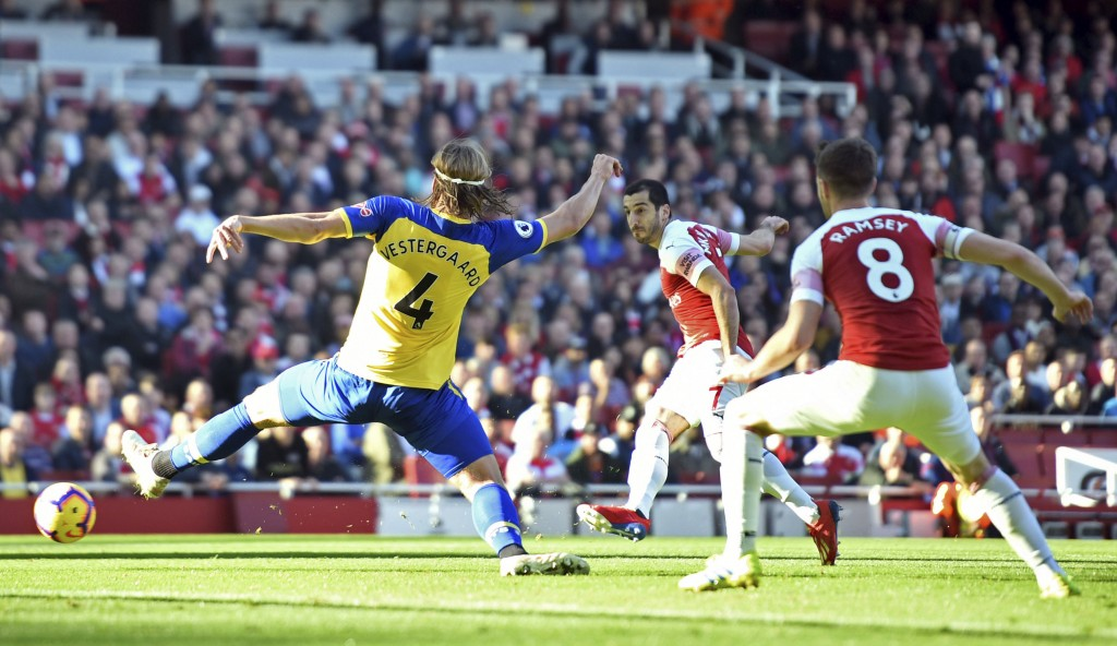 Arsenal's Henrikh Mkhitaryan, centre, scores his side's second goal of the game against Southampton, during their English Premier League soccer match ...