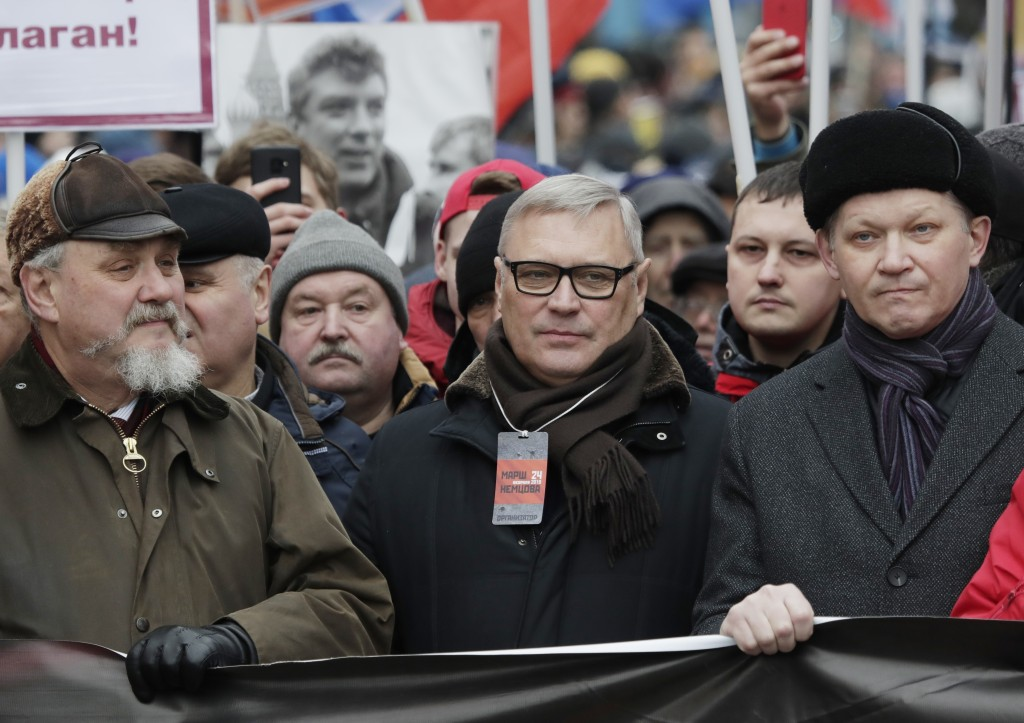 Former Russian Prime Minister, and one of opposition leaders, Mikhail Kasyanov, center, attends a march in memory of opposition leader Boris Nemtsov i...