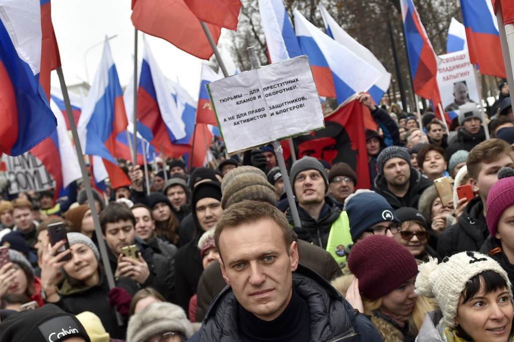 Russian opposition activist Alexei Navalny, center, takes part in a march in memory of opposition leader Boris Nemtsov in Moscow, Russia, Sunday, Feb....
