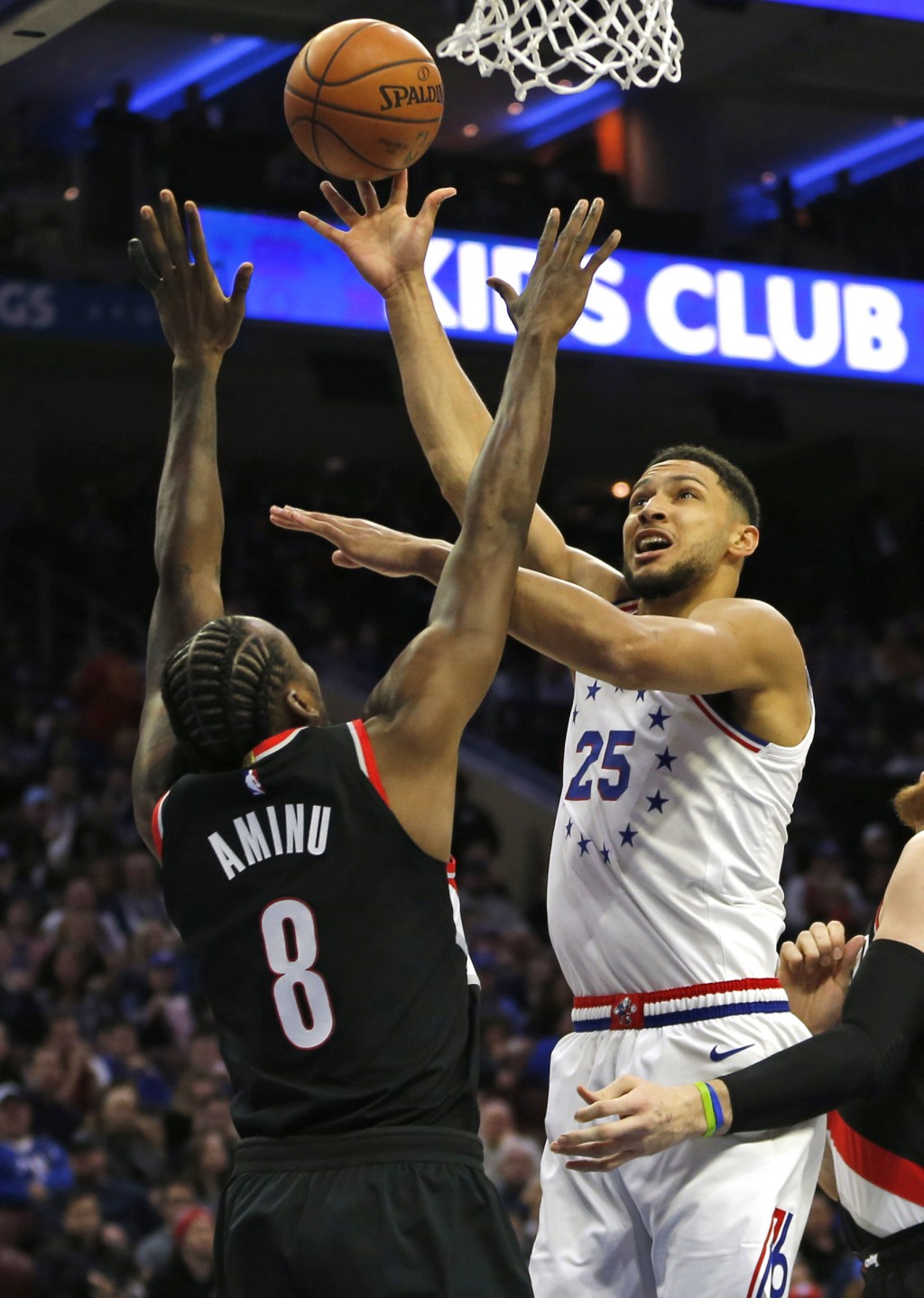 Philadelphia 76ers guard Ben Simmons (25) takes a shot over Portland Trail Blazers forward Al-Farouq Aminu (8) during the first half on an NBA basketb