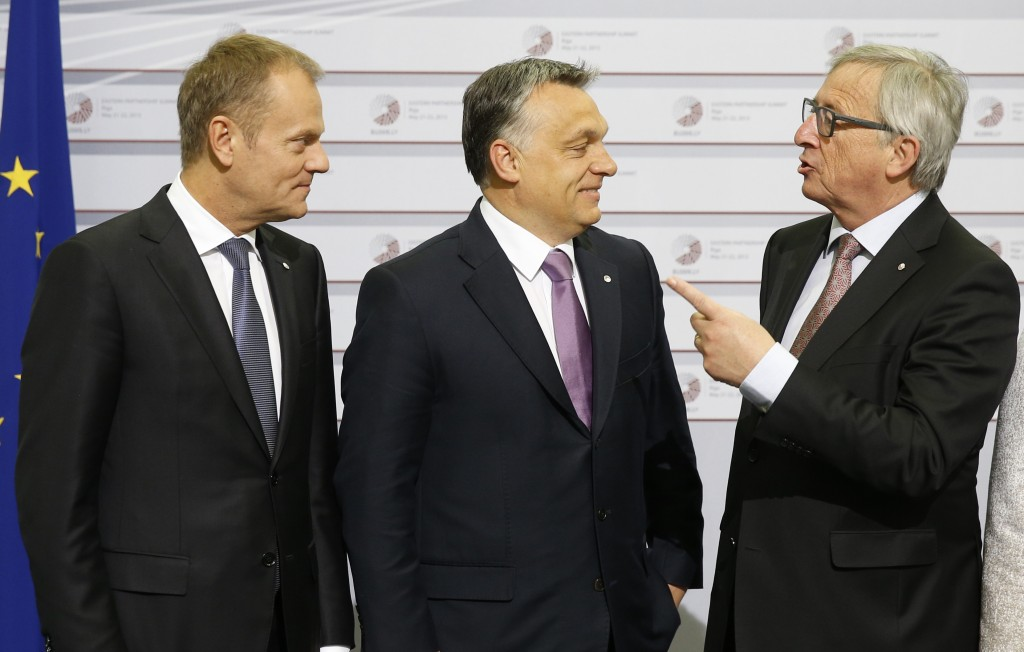 FILE - In this May 22, 2015 file photo, European Commission President Jean-Claude Juncker, right, and European Council President Donald Tusk, left, gr...