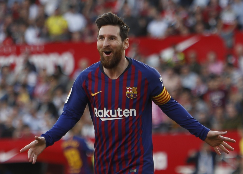 Barcelona forward Lionel Messi celebrates after scoring his side's second goal during La Liga soccer match between Sevilla and Barcelona at the Ramon ...