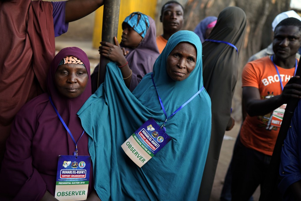 Nigerian election observers watch votes being counted in Kaduna, Nigeria, Saturday Feb. 23, 2019. Incumbent President Muhammadu Buhari is facing oppos
