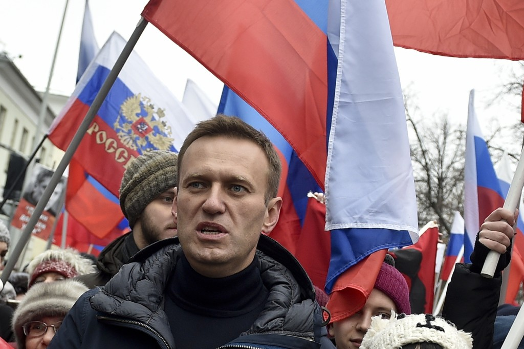 Russian opposition activist Alexei Navalny takes part in a march in memory of opposition leader Boris Nemtsov in Moscow, Russia, Sunday, Feb. 24, 2019...