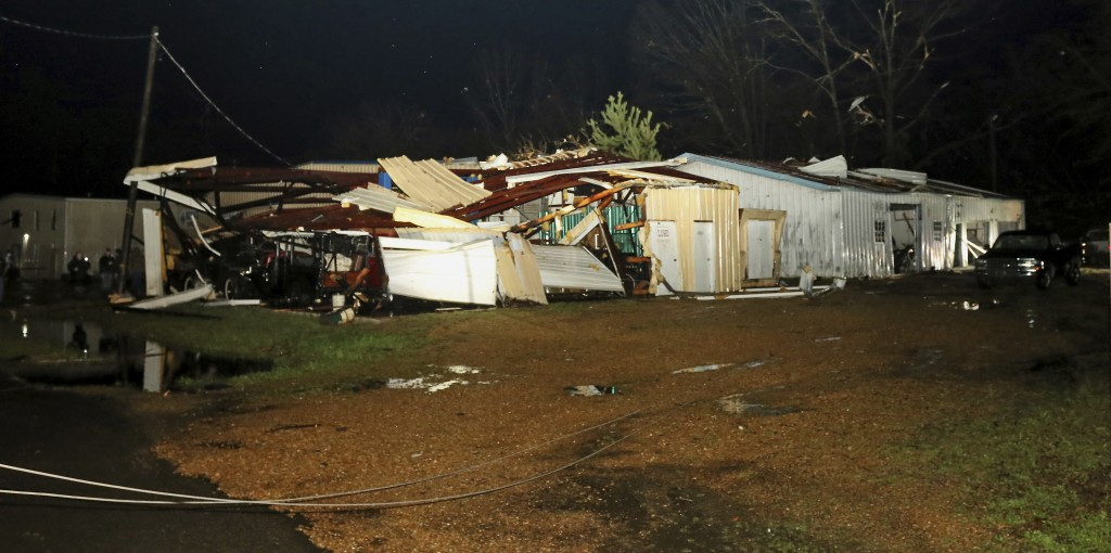 A building belonging to Lawrence Motors along Highway 50 in Columbus, Miss. is destroyed by a tornado on Saturday, Feb. 23, 2019. The building housed
