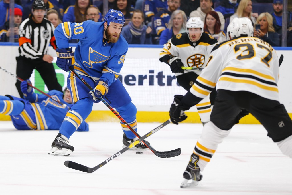 St. Louis Blues' Ryan O'Reilly (90) looks to pass the puck against the Boston Bruins during the second period of an NHL hockey game Saturday, Feb. 23,