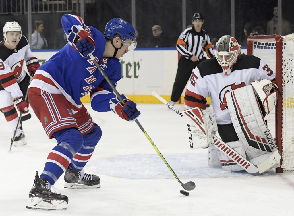 New York Rangers left wing Jimmy Vesey (26) skates in on New Jersey Devils goaltender Cory Schneider (35) during the second period of an NHL hockey ga