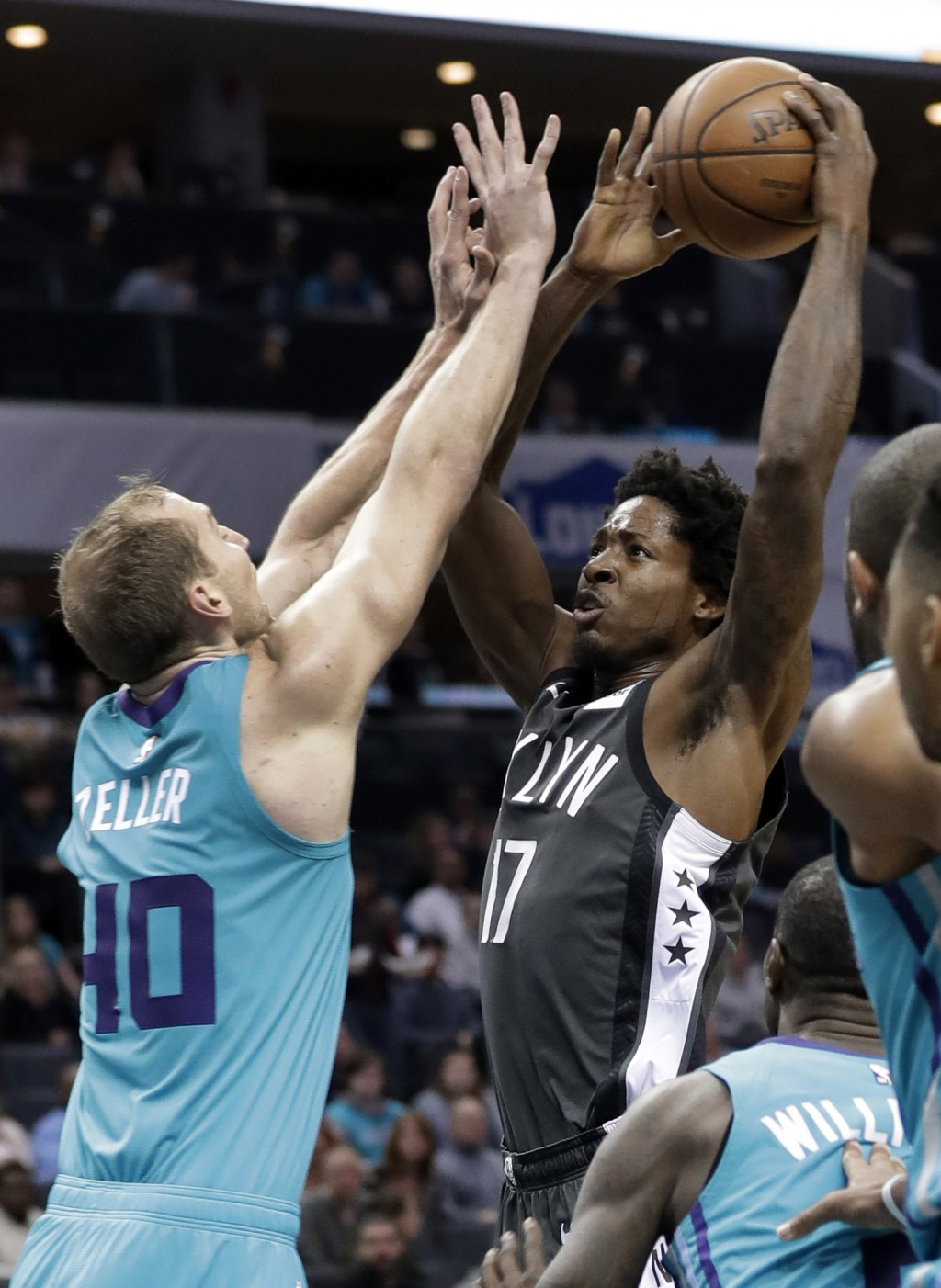 Brooklyn Nets' Ed Davis (17) drives against Charlotte Hornets' Cody Zeller (40) during the first half of an NBA basketball game in Charlotte, N.C., Sa