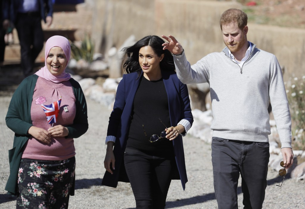Britain's Prince Harry and Meghan, Duchess of Sussex during a visit to an 'Education for All' boarding house in Asni Town in Morocco, Sunday, Feb. 24,