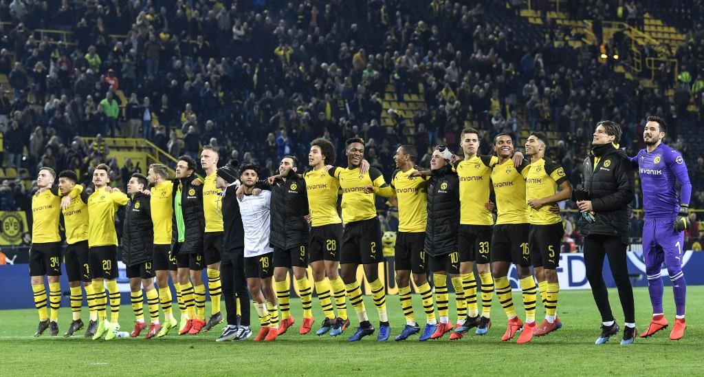 Dortmund's players celebrate after winning the German Bundesliga soccer match between Borussia Dortmund and Bayer Leverkusen in Dortmund, Germany, Sun