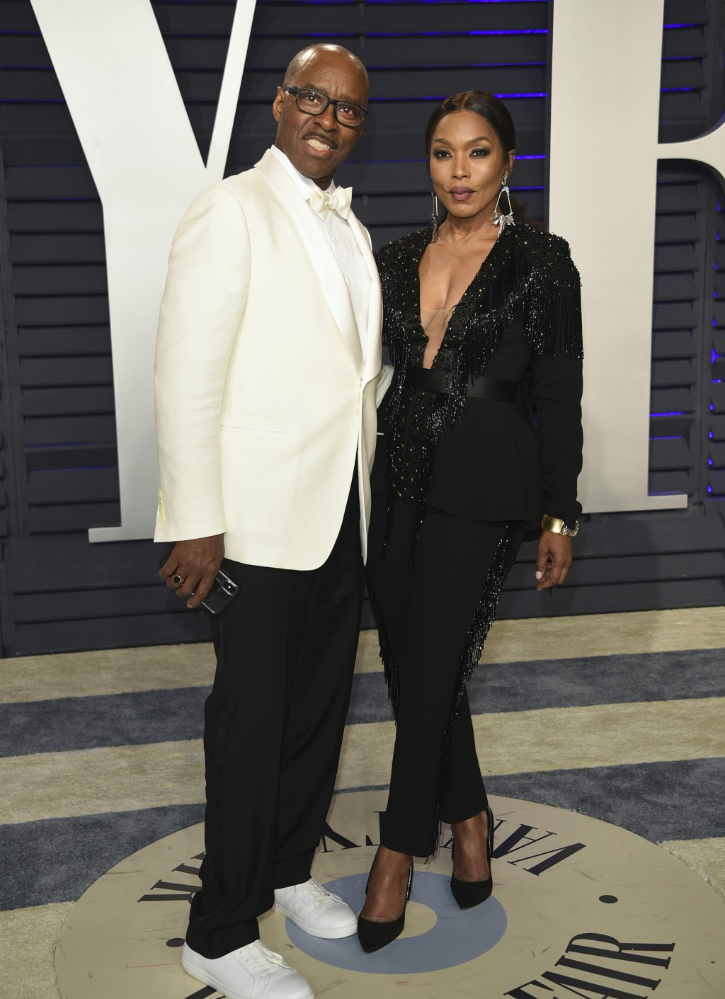 Courtney B. Vance, left, and Angela Bassett arrive at the Vanity Fair Oscar Party on Sunday, Feb. 24, 2019, in Beverly Hills, Calif. (Photo by Evan Ag
