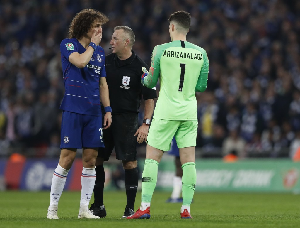 Chelsea's David Luiz, left, talks to Chelsea goalkeeper Kepa Arrizabalaga, right, during the English League Cup final soccer match between Chelsea and...