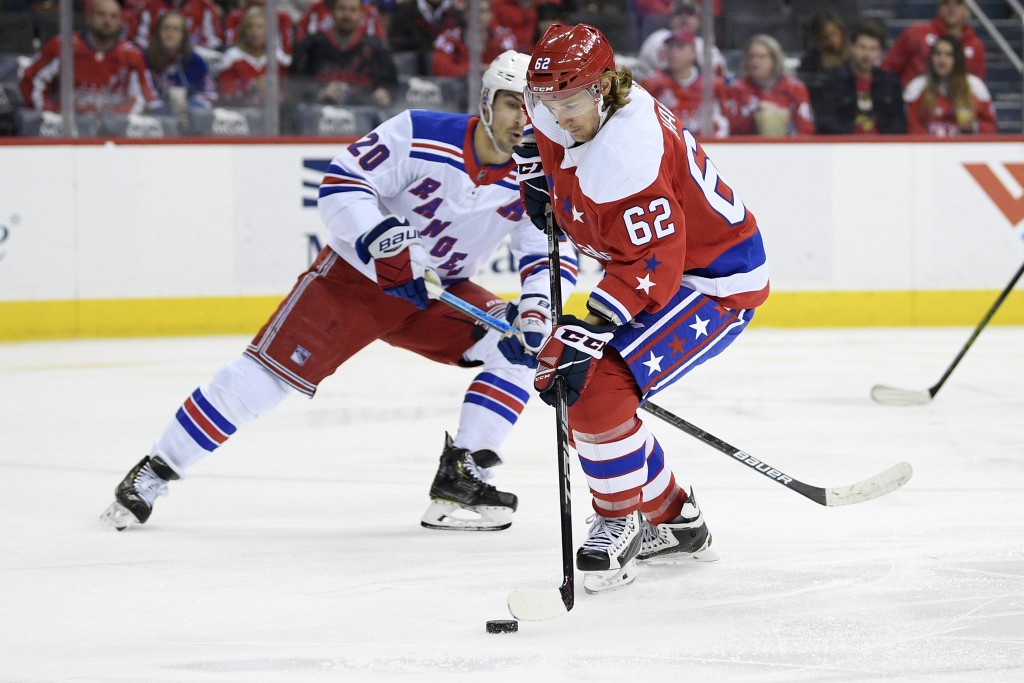 Washington Capitals left wing Carl Hagelin (62), of Sweden, skates with the puck against New York Rangers left wing Chris Kreider (20) during the seco