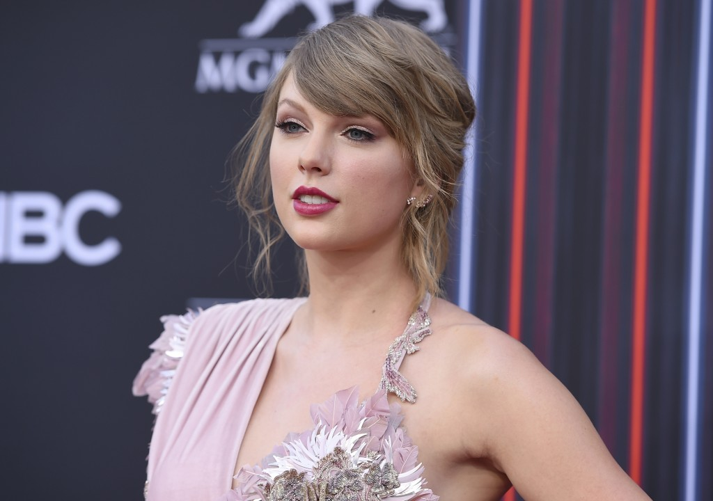 FILE - In this May 20, 2018 file photo, Taylor Swift arrives at the Billboard Music Awards at the MGM Grand Garden Arena, in Las Vegas. Swift helped a