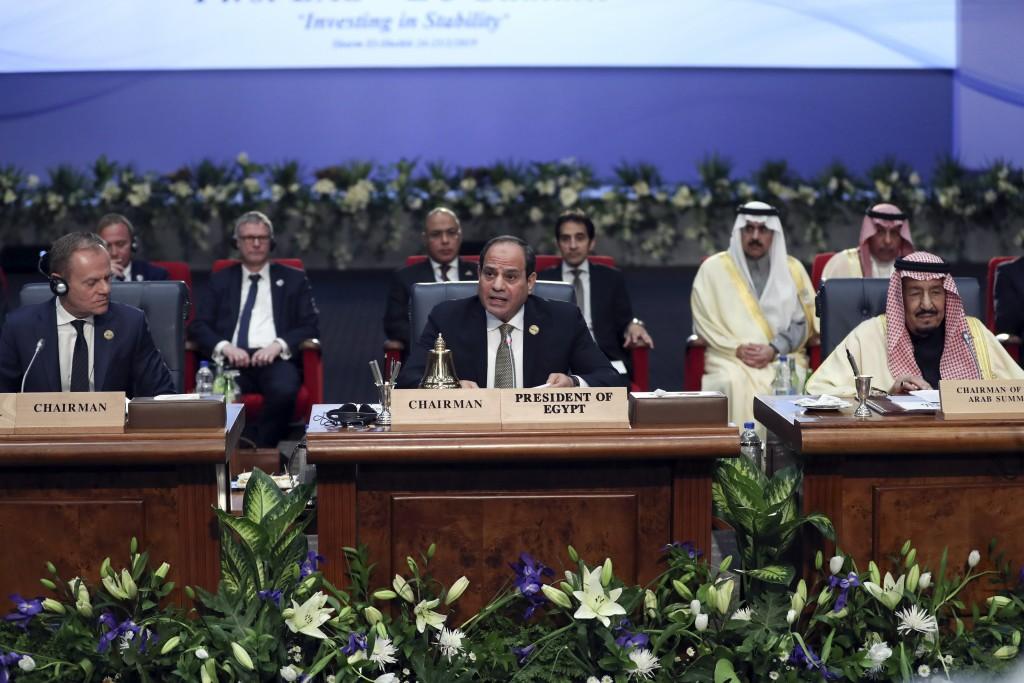 Egypt's President Abdel-Fattah El-Sisi, center, chairs a meeting at an EU-Arab summit at the Sharm El Sheikh convention center in Sharm El Sheikh, Egy...