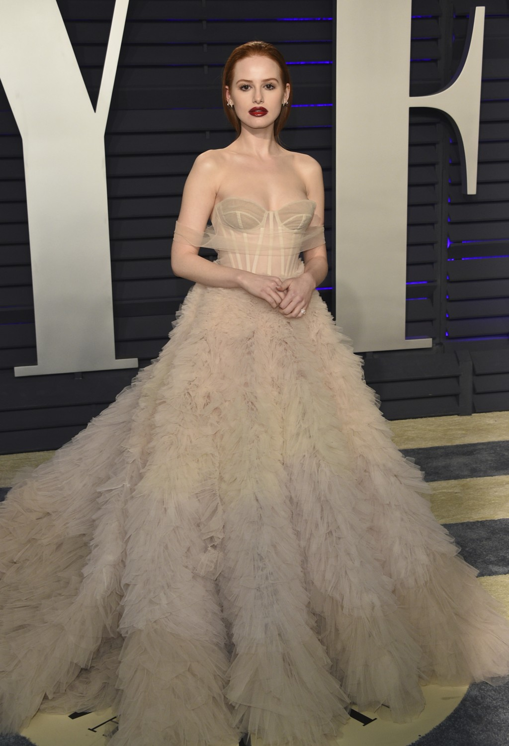 Madelaine Petsch arrives at the Vanity Fair Oscar Party on Sunday, Feb. 24, 2019, in Beverly Hills, Calif. (Photo by Evan Agostini/Invision/AP)