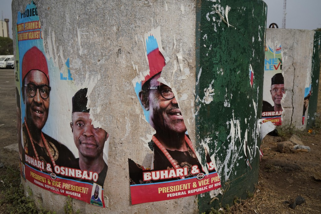 Torn posters of Nigerian Incumbent President Muhammadu Buhari are seen in Abuja Sunday Feb. 24, 2019. Buhari faced opposition presidential candidate A