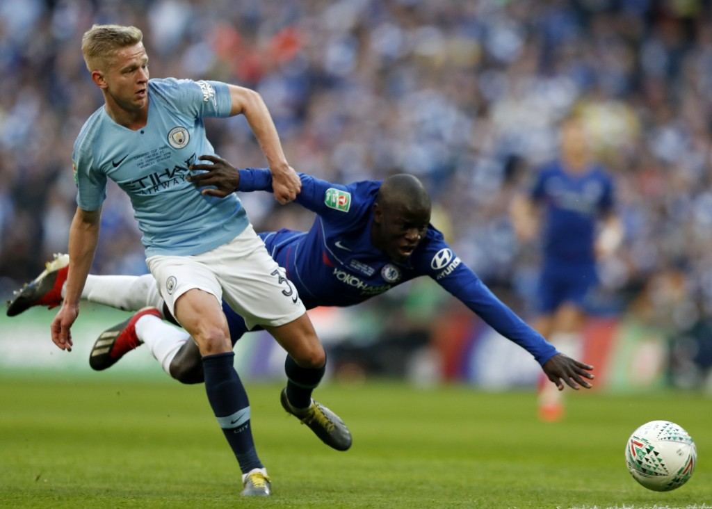 Manchester City's Oleksandr Zinchenko, left, challenges Chelsea's N'Golo Kantech, right, during the English League Cup final soccer match between Chel...