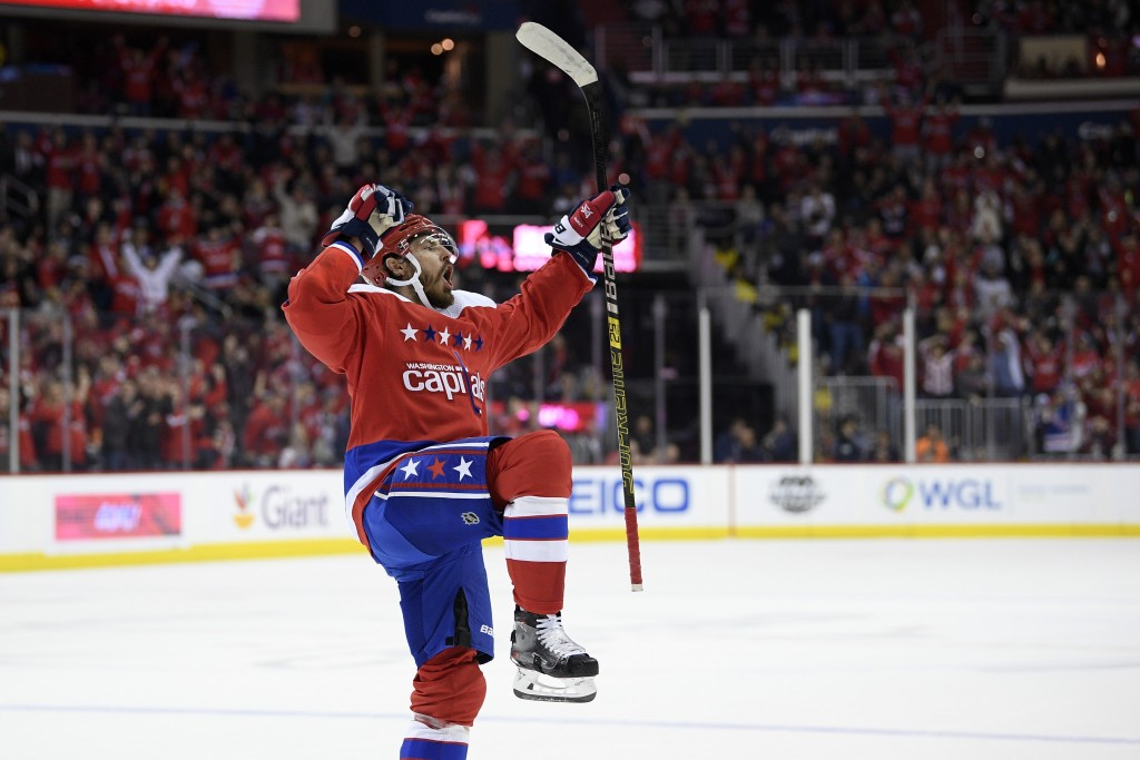 Washington Capitals defenseman Michal Kempny (6), of the Czech Republic, celebrates his goal during the first period of an NHL hockey game against the