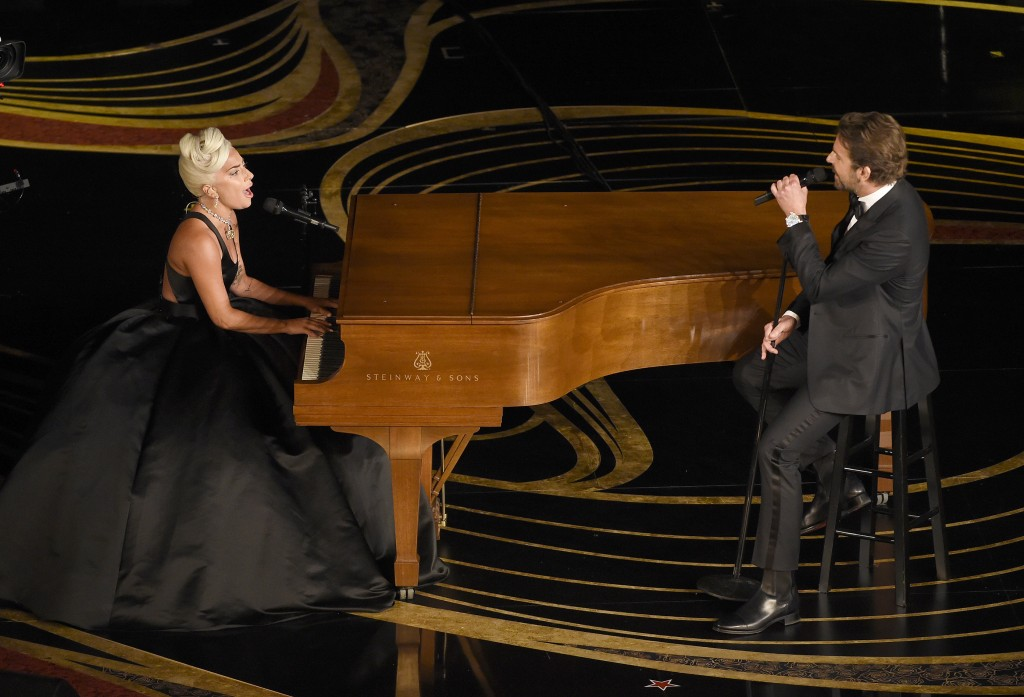 """Lady Gaga, left, and Bradley Cooper perform """"Shallow"""" from """"A Star is Born"""" at the Oscars on Sunday, Feb. 24, 2019, at the Dolby Theatre in Los Angele"""