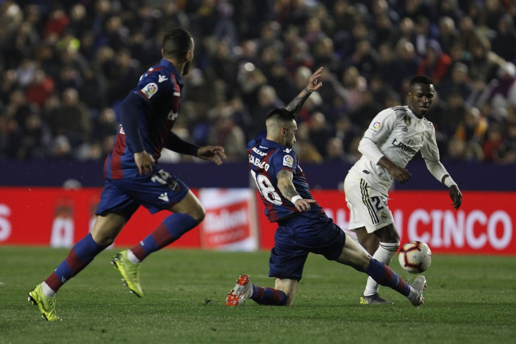 Real forward Vinicius Junior, right, fights for the ball with Levante's Erick Cathriel Cabaco during a Spanish La Liga soccer match at the Ciutat de V...