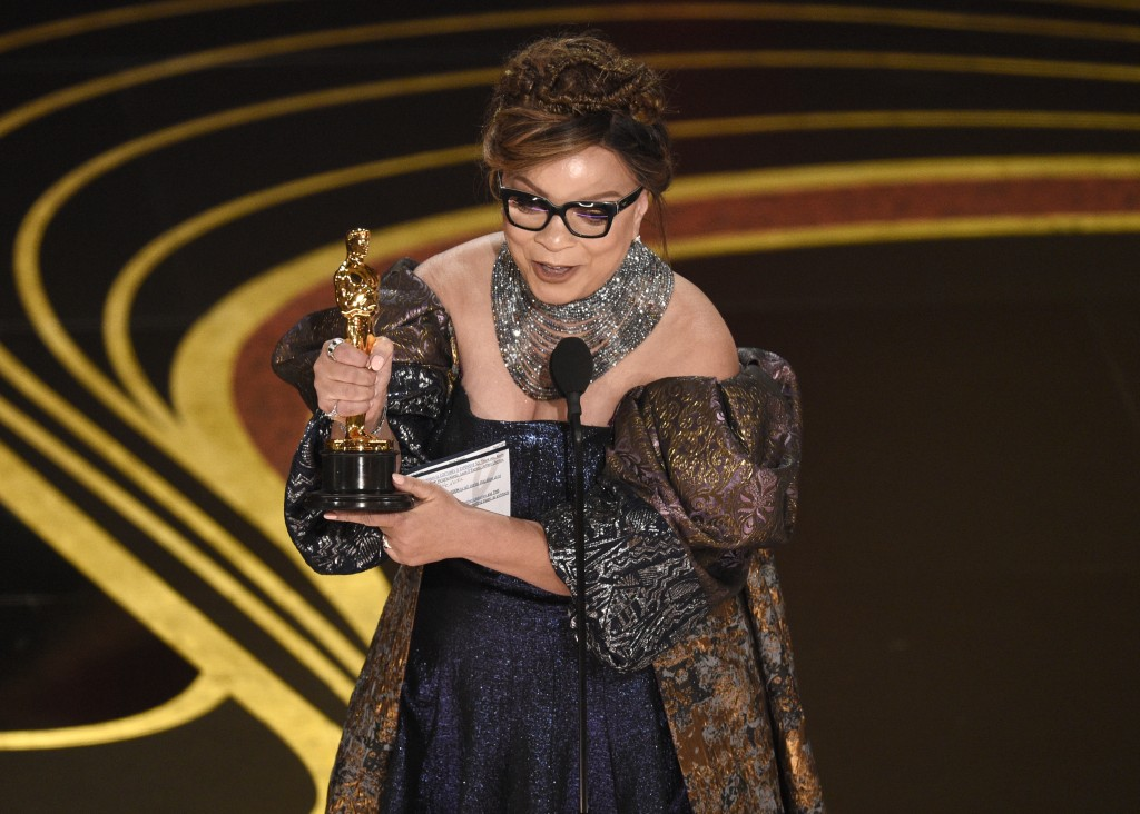 """Ruth E. Carter accepts the award for best costume design for """"Black Panther"""" at the Oscars on Sunday, Feb. 24, 2019, at the Dolby Theatre in Los Angel..."""