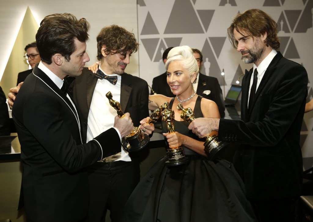 """Mark Ronson, from left, Anthony Rossomando, Lady Gaga, and Andrew Wyatt, winners of the award for best original song for """"Shallow"""" from """"A Star Is Bor"""