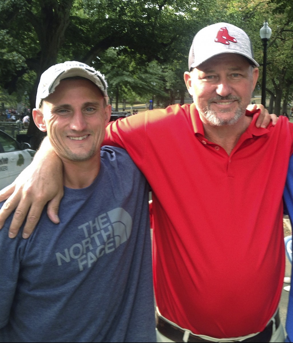 In this undated photo, Spencer Palozej, left, poses with his father Dean Palozej. Spencer Palozej died of a fentanyl overdose in Connecticut in 2018.