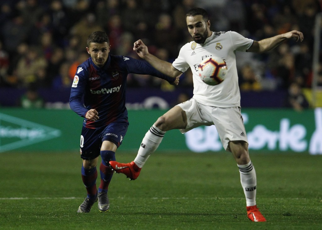 Real defender Dani Carvajal, right, fights for the ball with Levante's Bardhi during a Spanish La Liga soccer match at the Ciutat de Valencia stadium