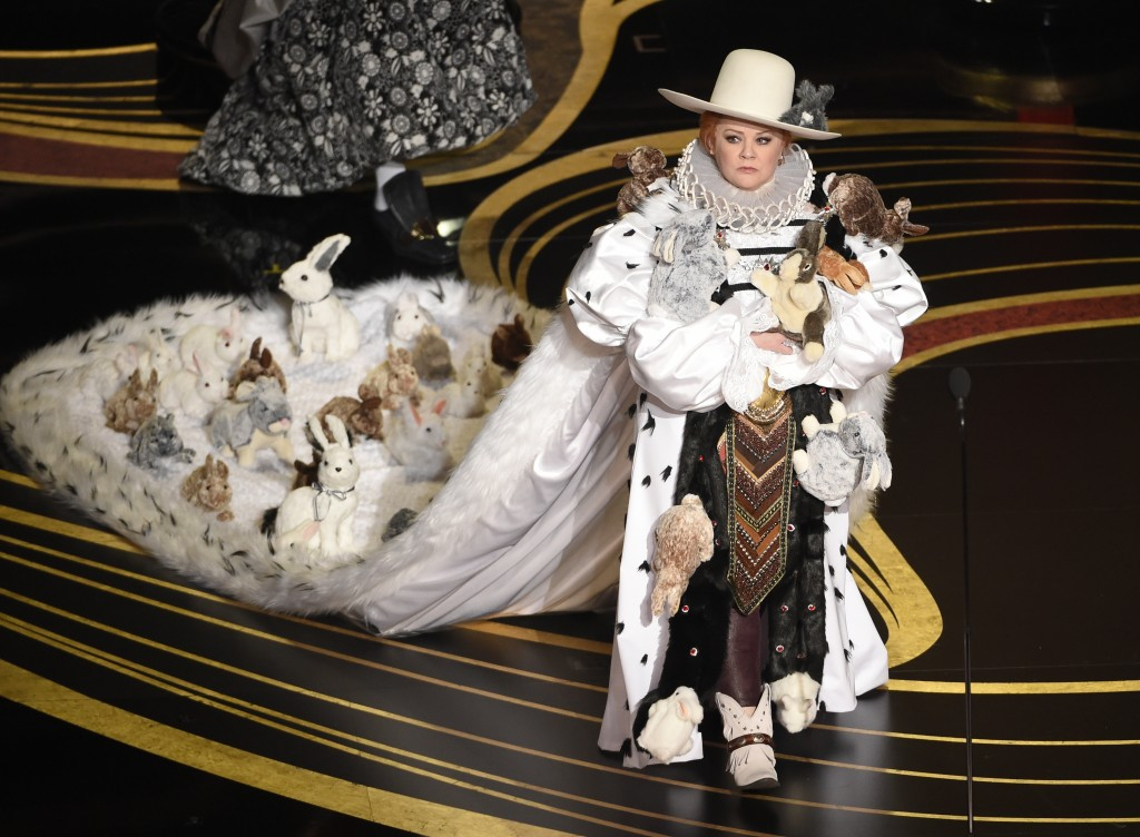 Melissa McCarthy walks on stage to present the award for best costume design at the Oscars on Sunday, Feb. 24, 2019, at the Dolby Theatre in Los Angel