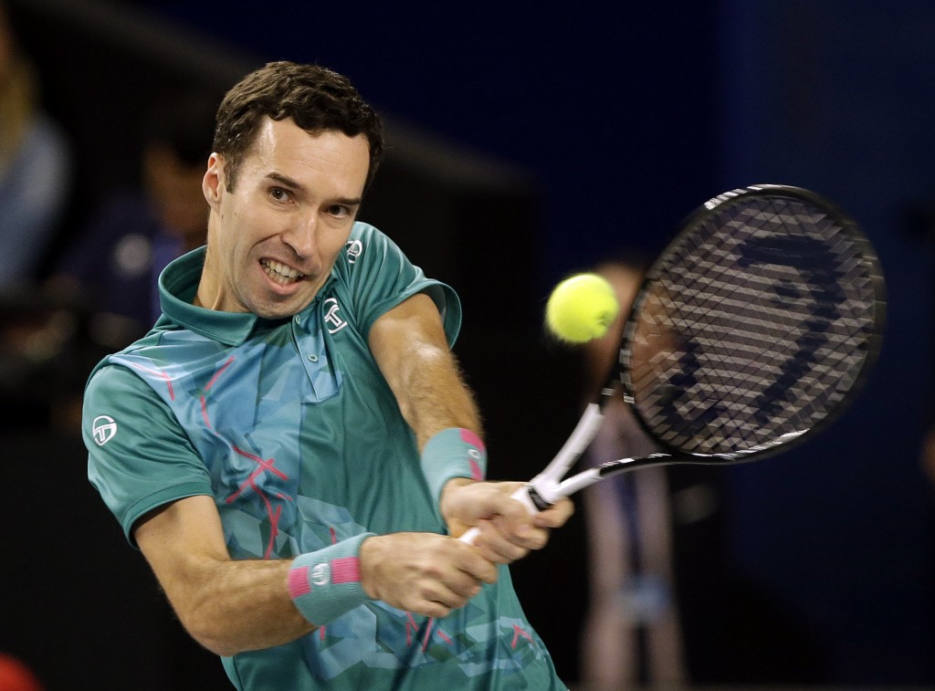 Mikhail Kukushkin of Kazakhstan returns the ball to Stefanos Tsitsipas of Greece during their final match at the Open 13 Provence tennis tournament in...