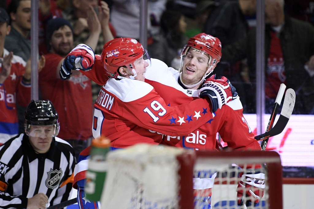 Washington Capitals center Nicklas Backstrom (19), of Sweden, celebrates his goal with defenseman John Carlson, right, during the first period of an N