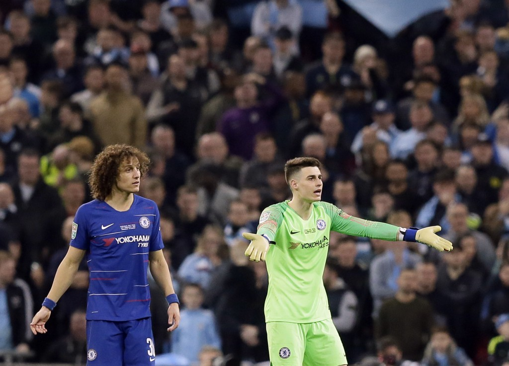 Chelsea goalkeeper Kepa Arrizabalaga, right, and Chelsea's David Luiz react during the English League Cup final soccer match between Chelsea and Manch