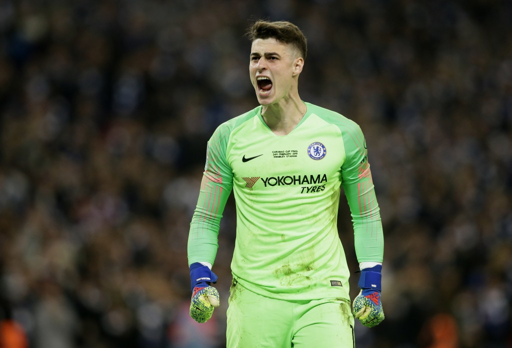 Chelsea goalkeeper Kepa Arrizabalaga reacts after stops a shot from Manchester City's Leroy Sane during a penalty shootout at the end of the English L...