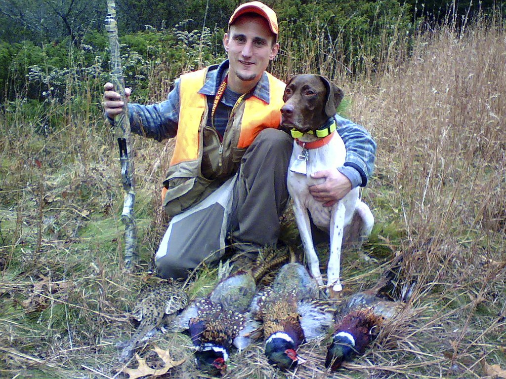 In this undated photo, Spencer Palozej poses with his dog after hunting in Connecticut. Palozej died of a fentanyl overdose last year. His father, Dea